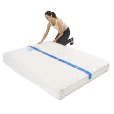 Woman packing queen bed